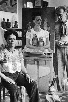 Frida Kahlo posing with a selfportrait