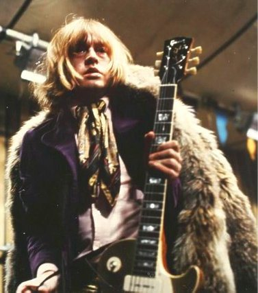 brian-with-guitar-and-coat