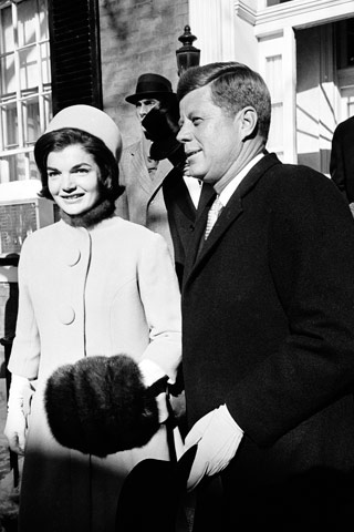 Jackie Kennedy, with her husband on Inauguration Day, January 20, 1961, wears a hat designed for her by Halston.