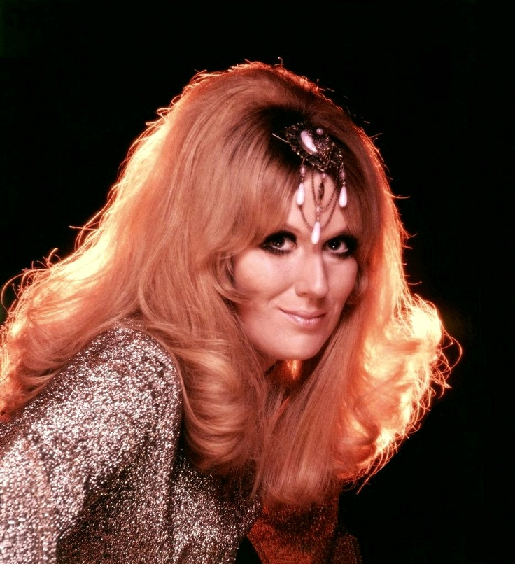Dusty Springfield rocked a Blonde Wig and a Column Dress