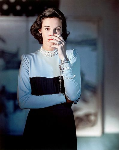 (Babe Paley) wearing a Creation of Traina-Norell, photographed by Horst P. Horst from American Vogue in 1946.