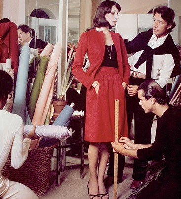 Sprouse, lower right, assists Halston with a fitting on actress Anjelica Houston in the early seventies