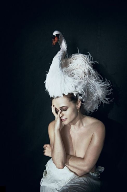 Helena Bonham Carter wears a fabulous swan headpiece by Stephen Jones for Giles Deacon