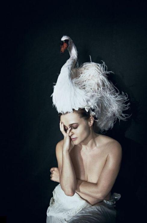 Helena Bonham Carter wears a fabulous swan headpiece by Stephen Jones for Giles Deacon