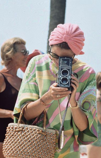 Grace Kelly was the most beautiful and chic woman. Here she's taking photos at a 1972