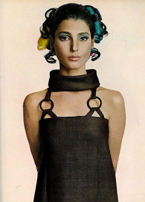 Benedetta Barzini in a brown, cowled linen dress by Christian Dior, photo by Avedon for Vogue 1967